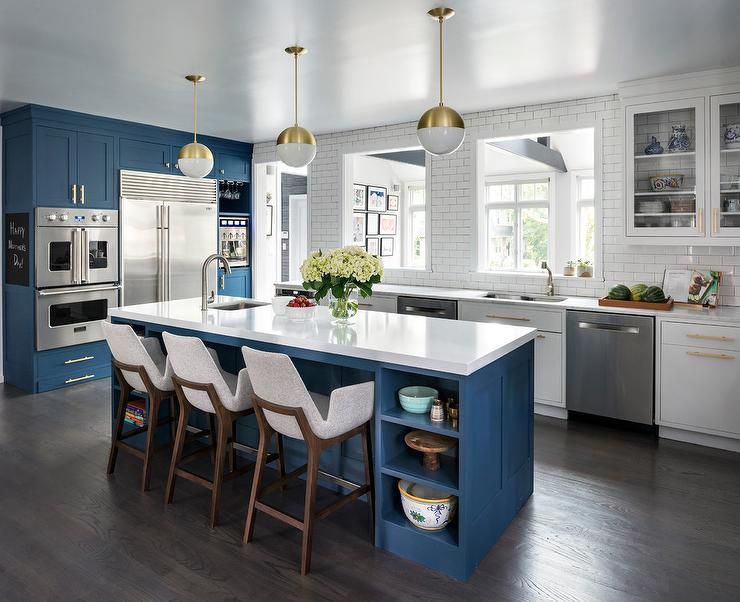 White And Gold Light Pendants With Blue Center Island