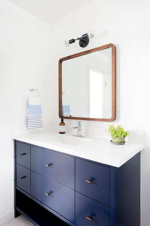 Blue Mid Century Modern Bathroom With Wooden Mirror