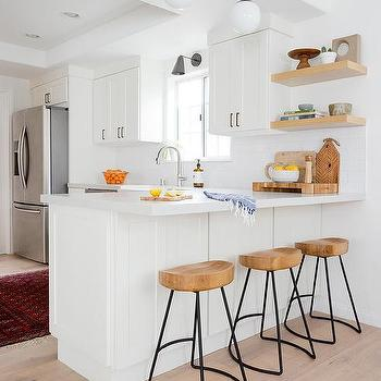 White and Glass Globe Light Pendants Over Kitchen Peninsula & Wood And Iron Backless Kitchen Bar Stools Design Ideas islam-shia.org