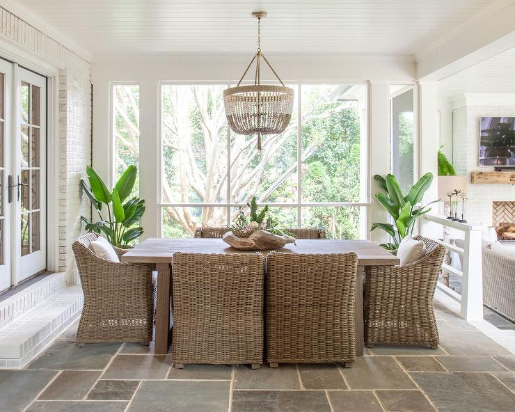Sunken Sunroom Dining Space With Slate Floor Tiles