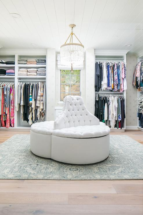 White Tufted Round Storage Settee In Walk In Closet