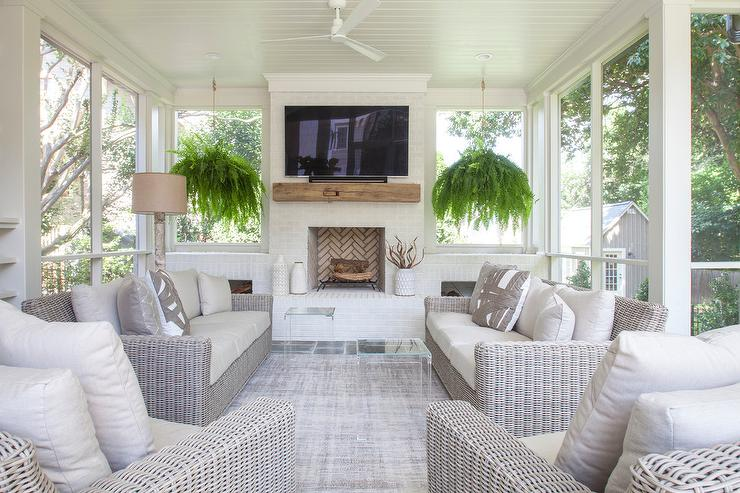 White Brick Fireplace And Hearth In Sunroom