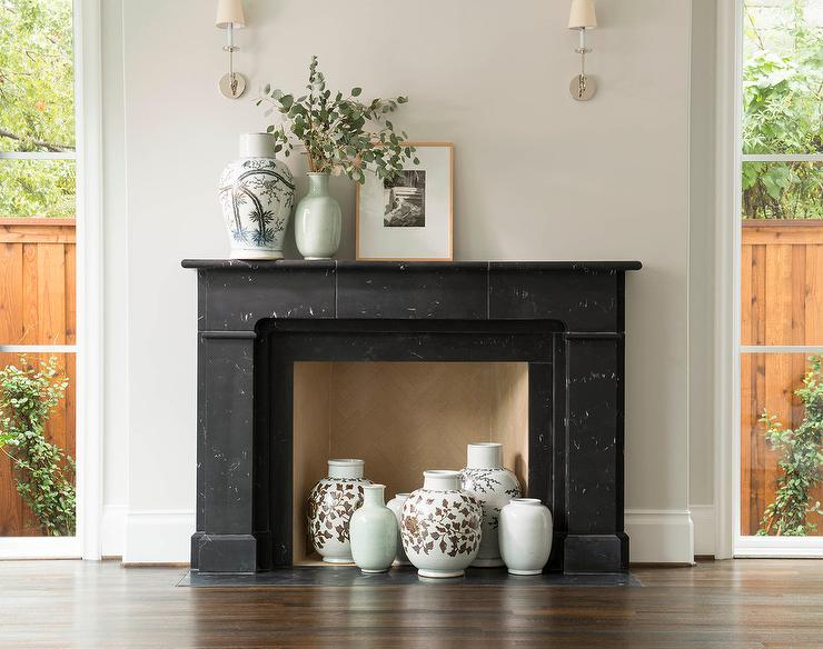 Black Marble Fireplace Mantel With Celadon Green Vases