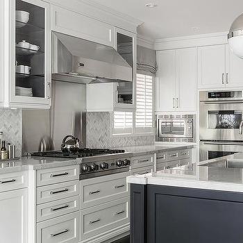 Marble Herringbone Tiles With Stainless Steel Cooktop Backsplash