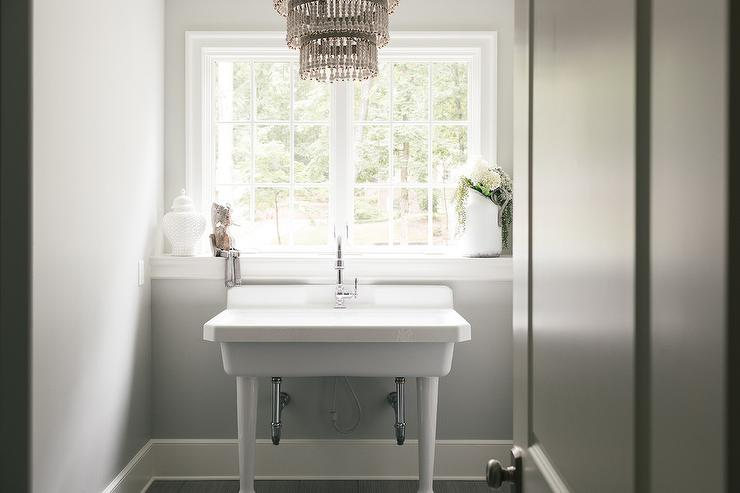 Beneath A Window Ledge Fixed Under An Uncovered Window, A Wide 2 Leg  Pedestal Sink Is Accented With A Polished Nickel Gooseneck Faucet And  Mounted In Front ...