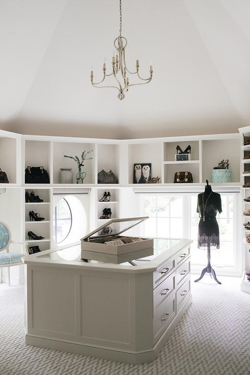 A Beaded Chandelier Hung From Vaulted Ceiling Illuminates This Stunning Custom Walk In Closet Boasting White Center Island Finished With Mirrored