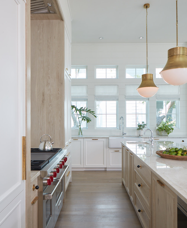 ... A Light Oak Island Accented With A Light Gray Stone Countertop Finished  With A Prep Sink And A Polished Nickel Gooseneck Faucet Lit By Kelly  Wearstler ...