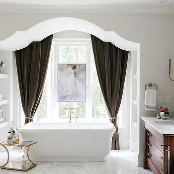 Bathtub Alcove With Brown Velvet Curtains Traditional