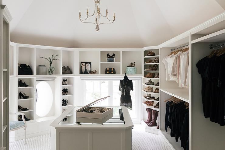 A Jewelry Cabinet Sits Atop Mirror Top Closet Island Illuminated By Beaded Chandelier Hung From Vaulted Ceiling