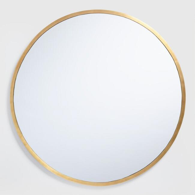 Round thin brass frame mirror