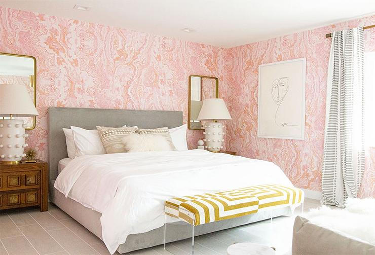sherman samuel pink agate wallpaper mural and features a gold geometric lucite bench placed on gray woodlike floor panels in front of a room u0026 board