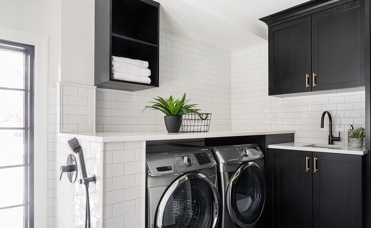 white subway tiles in black and white laundry room - transitional