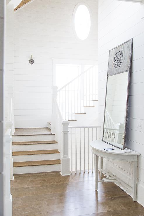 Gray Distressed Leaner Mirror Over Whitewashed Half Moon Table