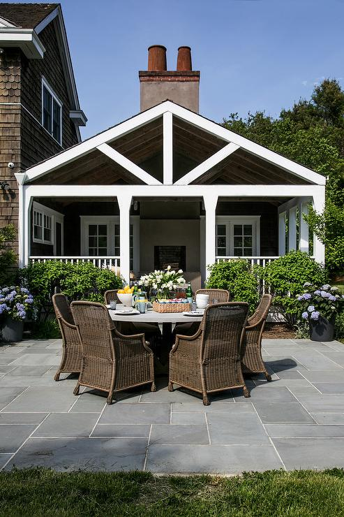 Round Concrete Patio Table with Wicker Dining Chairs