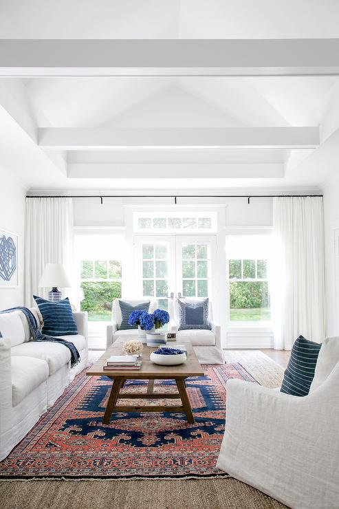 matching chairs for living room. Well lit cottage living room features a white slipcovered sofa  matching accent chairs and blue pillows around wood trestle coffee table Accent Chairs Matching Living Room Sofa Design Ideas