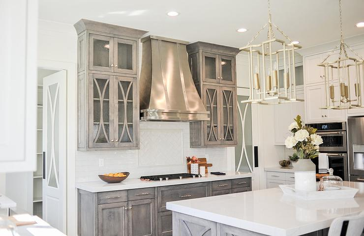 Beautifully designed kitchen is fitted with a glass mullion pantry door positioned near a stainless steel French hood mounted between light gray mullion ... & Glass Mullion Pantry Door Design Ideas
