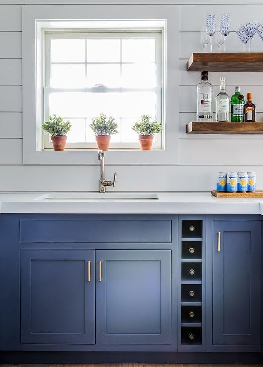 White Shiplap Kitchen With Wood Cabinets