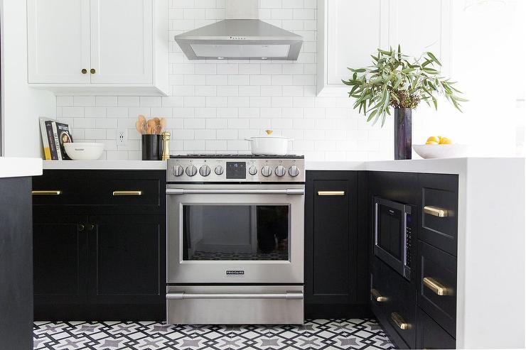 Rejuvenation Larkin Bin Pulls Accent Black Ikea Cabinets Contrasted With A  White Quartz Countertop Fixed On Either Side Of A Frigidaire Stove Placed  On Cle ...