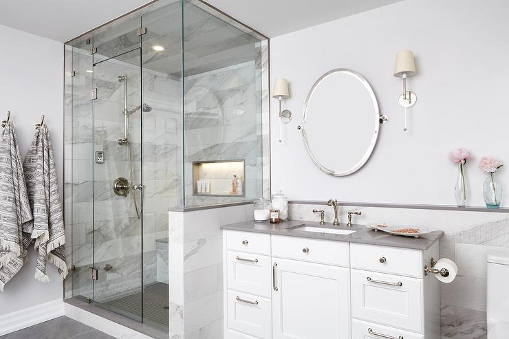 Oval Pivot Mirror With Nickel And Glass Sconces