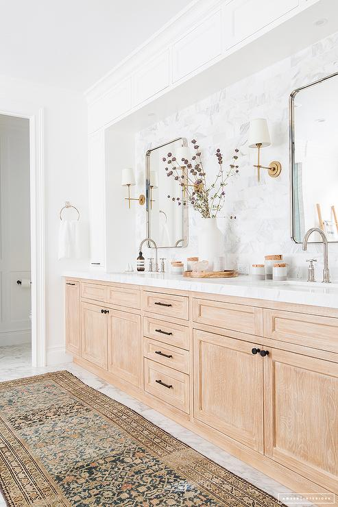 'view full size' from the web at 'https://cdn.decorpad.com/photos/2017/09/01/light-stained-oak-washstand-under-white-cabinets.jpg'