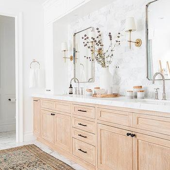 'Mixed Metals in Bathroom' from the web at 'https://cdn.decorpad.com/photos/2017/09/01/m_light-stained-oak-washstand-under-white-cabinets.jpg'
