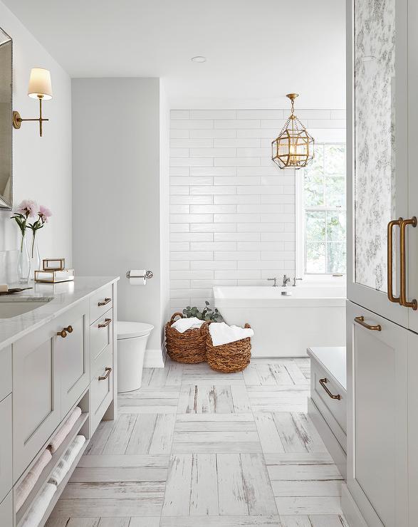 Glass And Brass Lantern Over Bathtub Transitional Bathroom