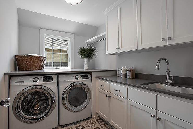 Gray Laundry Room With Blond Washstand And Farm Sink