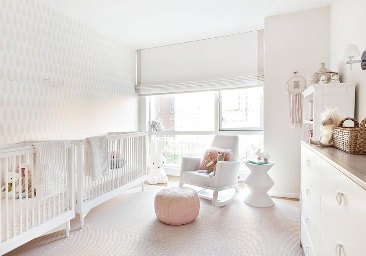 white twin girls nursery design with side by side cribs