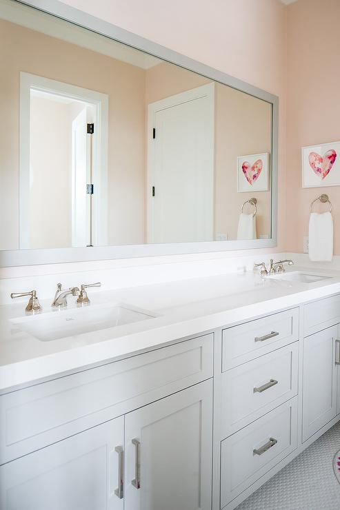 Pink girls bathroom with gray glass tiles transitional for Pink and grey bathroom accessories