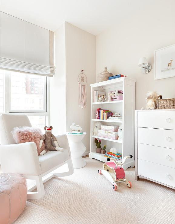 Nursery White Rocking Chair With Pink Pouf