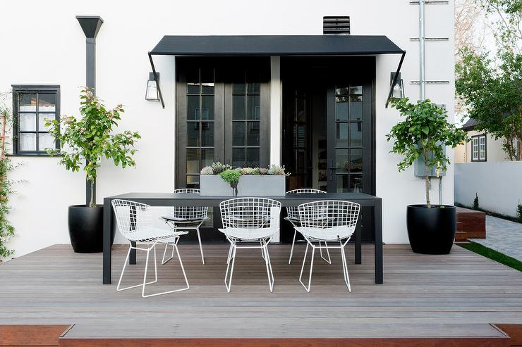 Long Black Outdoor Dining Table With White Bertoia Chairs - White metal outdoor dining table