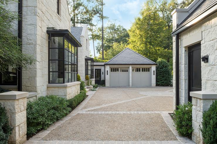 Stone Double Car Garage With Dove Gray Doors Cottage Home Exterior