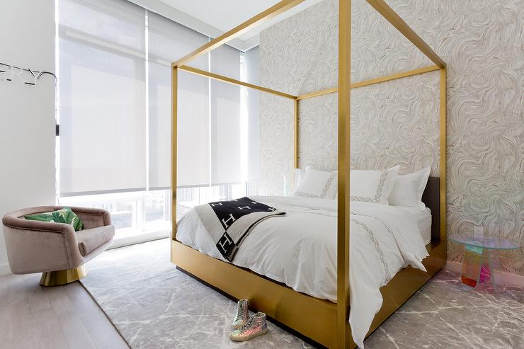 Gold Canopy Bed With Black Heres Throw Blanket Photo