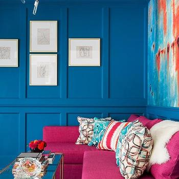 Blue Paneled Living Room With Hot Pink Sofa