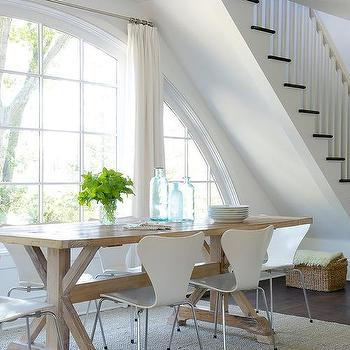 White Plastic Dining Chairs With Caramel Stained Trestle Dining Table
