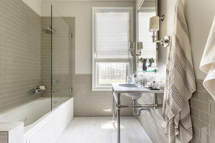 Horizontal Gray Glass Brick Shower Backsplash Tiles Frame The Walls Of A Bathroom Continuing Onto Perimeter
