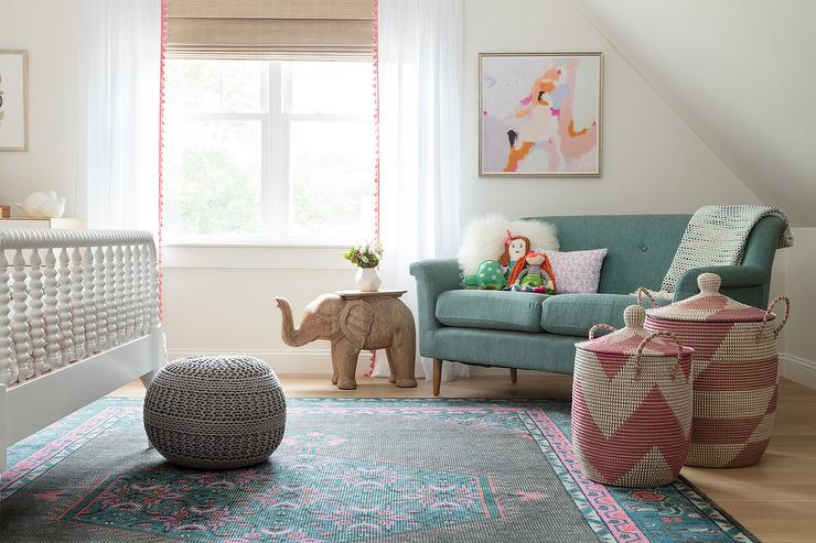 Green Vintage Sofa With Pink And Blue Rug