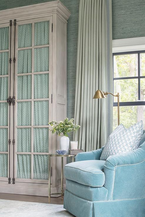 Blue velvet club chair with green curtains cottage bedroom for Chair next to window