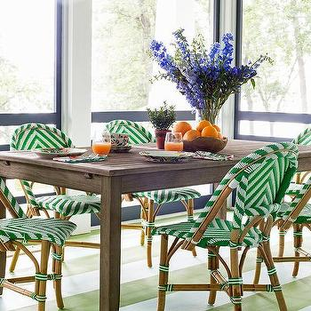 green striped floor with slatted wood dining table