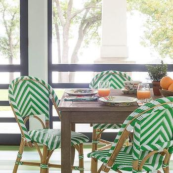 green rattan dining chairs with green striped floor