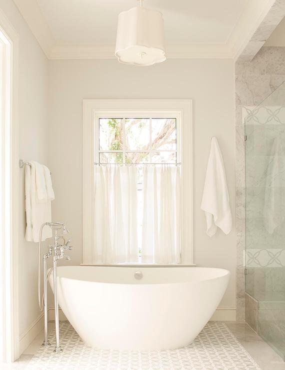 Barbara Barry Simple Scallop Pendant Over Oval Soaking Tub ...