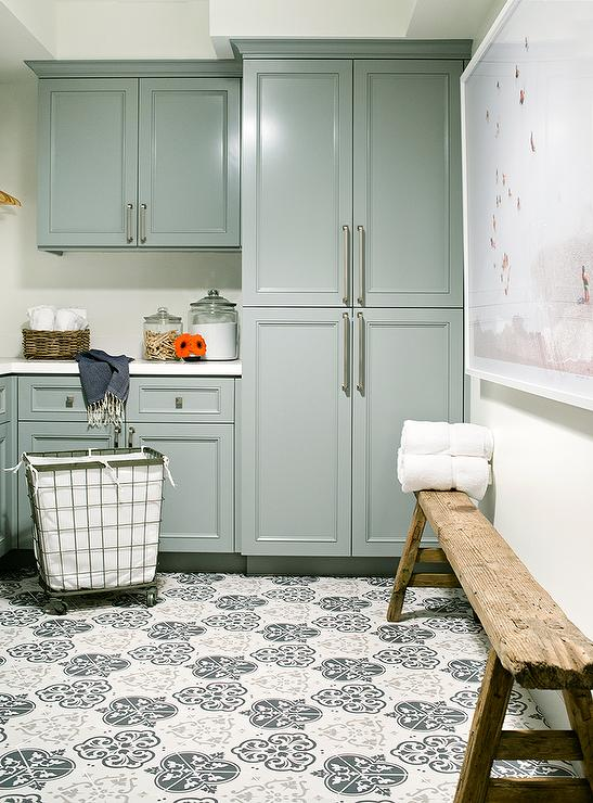 Charmant ... Appointed Laundry Room Features A Rustic Sawhorse Bench Placed Beneath  A Large Beach Art Piece Hung Adjacent To Floor To Ceiling Green Cabinets  Finished ...