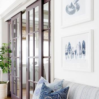 glass pocket doors. blue striped settee with pillows glass pocket doors s