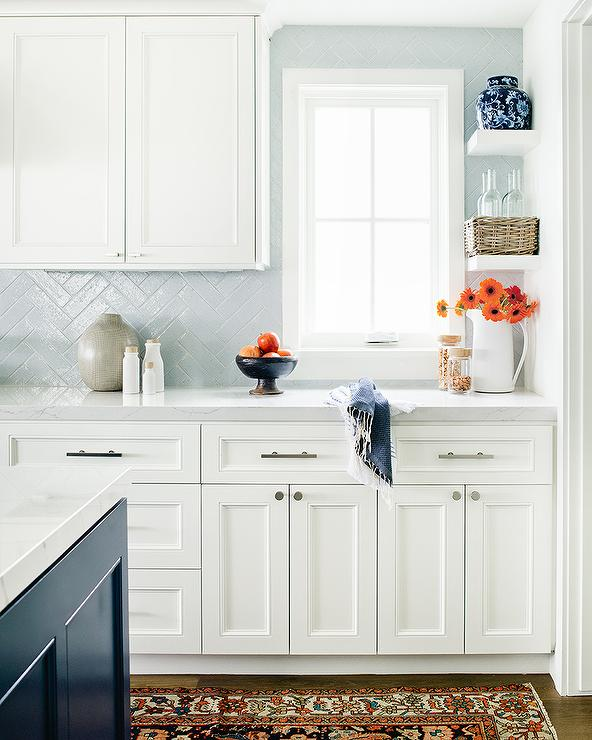 Light Blue Herringbone Tiles With White Cabinets Transitional Kitchen