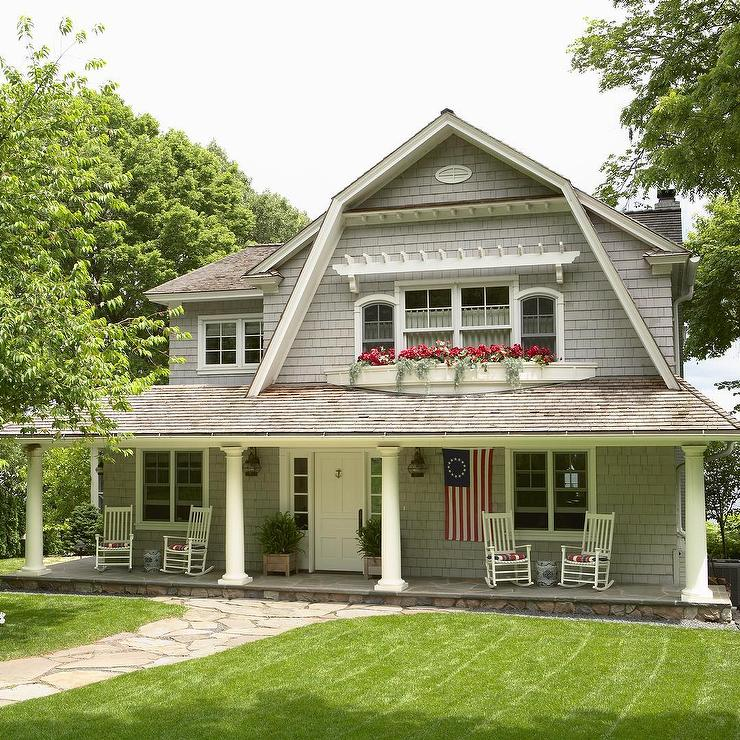 Traditional 2 Story Dutch Colonial Gray Siding House