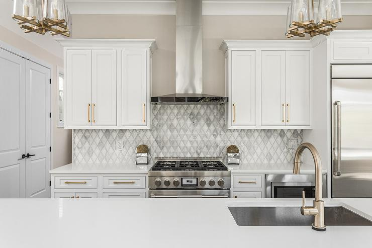 White And Gold Kitchen With Long Brushed Brass Pulls Contemporary Kitchen