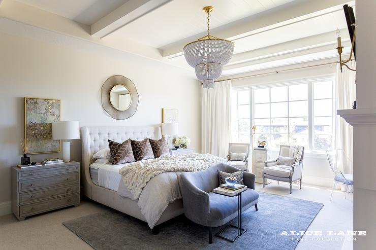 Small Bedroom Sitting Area With Cream Tufted Chairs And