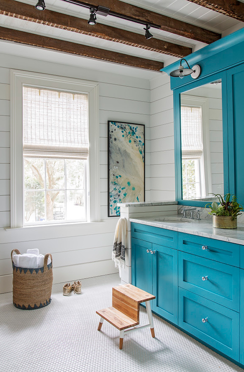 island blue bath vanity cabinets under rustic wood beams