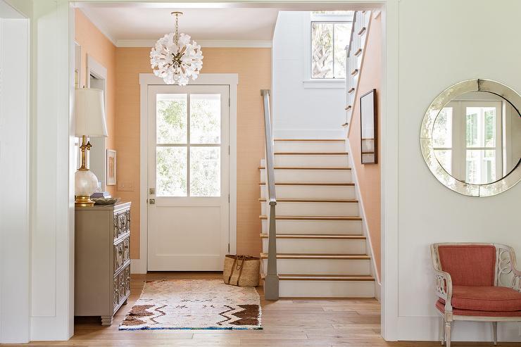 Peach Foyer Walls With Gray Dresser