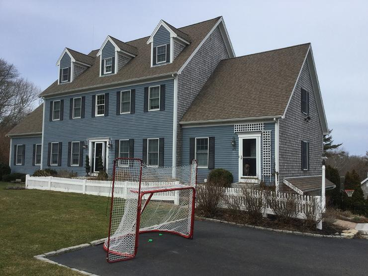 traditional 2 story blue cape cod house